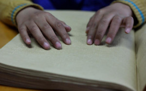 Reading braille at China Braille Library
